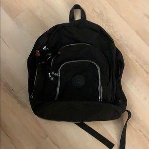 Black Kipling backpack (expandable)